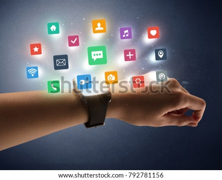 Naked female hand with smartwatch and  application labels around and dark background #792781156