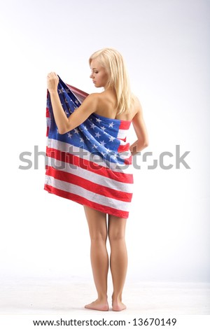 Naked girl in American flag stand on a white backgrund