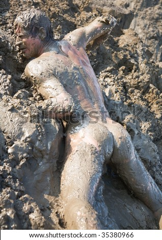stock-photo-naked-man-covered-in-mud-353