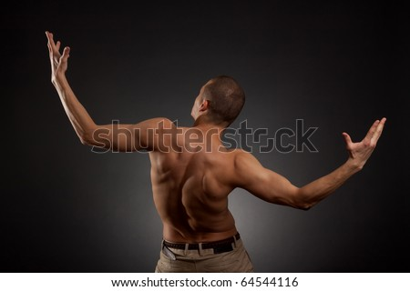 naked man rotated his back on a white background