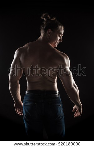 naked torso male bodybuilder athlete in the studio on a black background #520180000