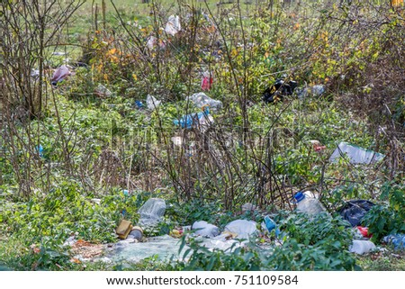 Naked tree branches at mountainside in late autumn with garbage all around. Beautiful, colorful nature background #751109584