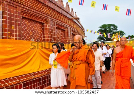 NAKHON PATHOM,THAILAND-JUNE 4: Clergy and Buddhist parade with yellow robe of Buddhist monk covering the golden pagoda in Visakha Bucha day to show respect and faith,4 June 2012 at Nakhon Pathom,Thai