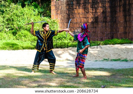 Nakhon Pathom, Thailand - May 24, 2014: Fighters exercise for Thai traditional martial arts demonstration at Samphran Elephant Ground & Zoo on May 24, 2014 in Nakhon Pathom,Thailand.