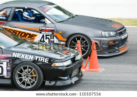 NAKHON RATCHASIMA - AUGUST 12: Two participants waiting to race at M-150 Storm Drift Competition at Bonanza Racing Circuit, Nakhon Ratchasima,Thailand on August 12, 2012.