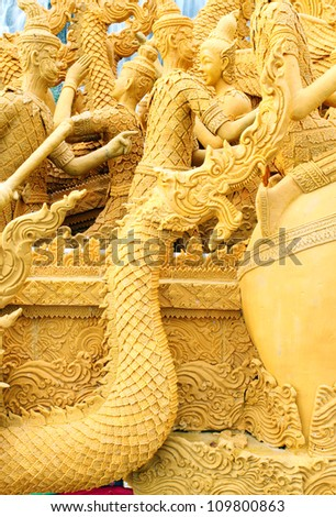 NAKHON RATCHASIMA, THAILAND - AUGUST 5: King of Naga candle wax carving Thai style texture in the traditional parade active festival Buddhist Lent on August 5, 2012 in Nakhon Ratchasima, Thailand