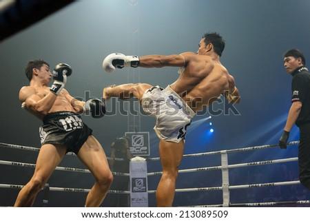 Nakhon Sawan THAILAND- August 16 Unidentified boxers compete in Thai Fight Muay Thai World's Unrivaled Fight on August 16 2014 in Nakhon Sawan Thailand