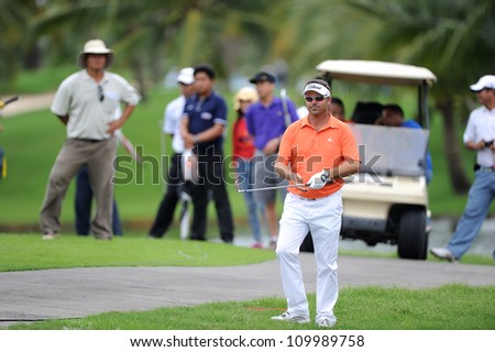NAKHONPATHOM,THAILA ND-AUG 10: Andre Stolz of AUS watches the line up before hits a shot during day two of the Golf Thailand Open at Suwan Golf Club on August 10, 2012 in Nakhonpathom Thailand