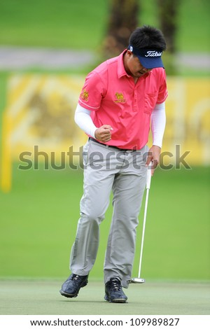 NAKHONPATHOM,THAILA ND-AUG 10:Wisut Artjanawat of THA waves to supporters after a putt during  day two of the Golf Thailand Open at Suwan Golf Club on August 10, 2012 in Nakhonpathom Thailand