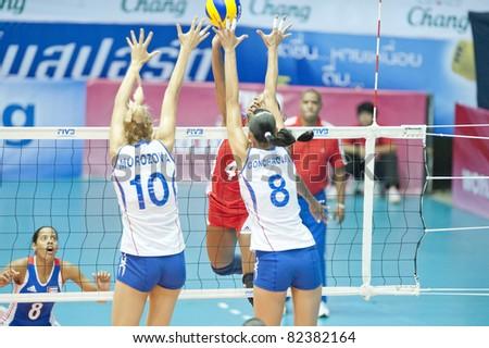 NAKHONPATHOM,THAILAND - AUGUST 5 : Morozova Luliia (10) and Goncharova Nataliya blocks the ball at Volleyball World Championships 2011 Russia vs Cuba at Nakhonpathom in Thailand on August 05, 2011