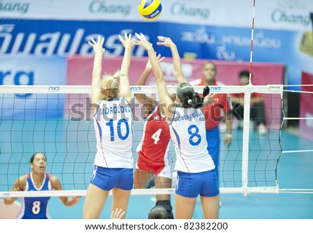 NAKHONPATHOM,THAILAND - AUGUST 5 : Morozova Luliia (10) and Goncharova Nataliya blocks the ball at Volleyball World Championships 2011 Russia vs Cuba at Nakhonpathom in Thailand on August 05, 2011