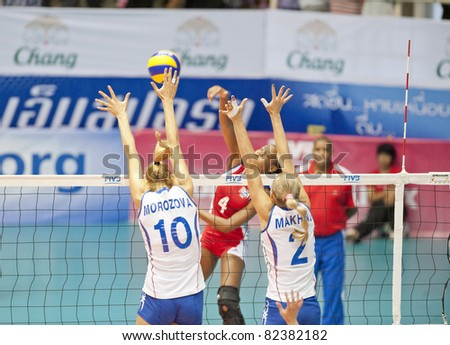 NAKHONPATHOM,THAILAND - AUGUST 5 : Morozova Luliia (10) blocks the ball at Volleyball World Championships 2011 Russia vs Cuba at Nakhonpathom in Thailand on August 05, 2011