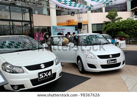 NAKHONRATCHASIMA,THAILAND-MARCH,24: Susuki SX4 and New Swift on display at the Northeast Motor Show during 24-31 March 2012,March 24,2012 at the Mall department store in Nakhonratchasima,Thailand.