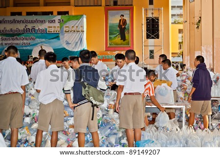 NAKHONRATCHASIMA, THAILAND - NOV 19 : Schoolboy volunteers collected relief supplies for sufferers about flood crisis in Thailand on November 19, 2011 in Nakhonratchasima, Thailand.