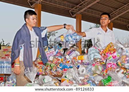 NAKHONRATCHASIMA, THAILAND - NOV 19 : Unidentified schoolboy volunteers collect relief supplies for sufferers about flood crisis in Thailand on November 19, 2011 in Nakhonratchasima, Thailand.