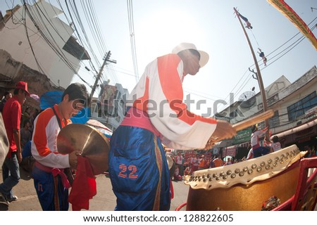 NAKORNSAWAN,THAILAND - FEB 13: A drum performer participates in the Chinese New Year Parade on February 13, 2013 in the Nakornsawan city ,Middle of Thailand.