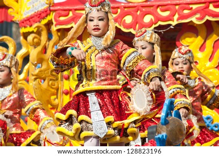 NAKORNSAWAN,THAILAND-FEB 13 : Unidentified young girls provide music for dance on the parade during Chinese New Year celebrations on February 13, 2013 in Nakornsawan city,Middle of Thailand.