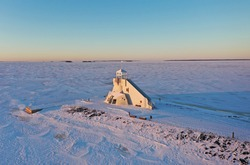 Nallikari Lighthouse at Bothnian bay of Baltic Sea in Oulu, Northern Ostrobothnia, Finland in sunny day in winter times