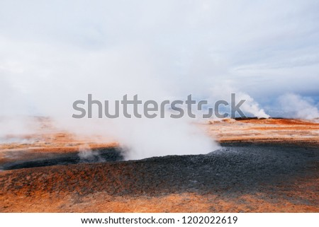 Namafjall - geothermal area in field of Hverir. Landscape which pools of boiling mud and hot springs. Tourist and natural attractions in Iceland