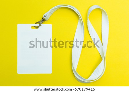 Name id card badge with cord on yellow background, empty space for text. #670179415