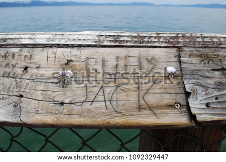 name jack carved into wooden...