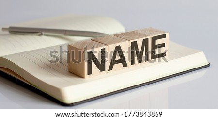 NAME sign on a wooden block on notebook background ストックフォト ©