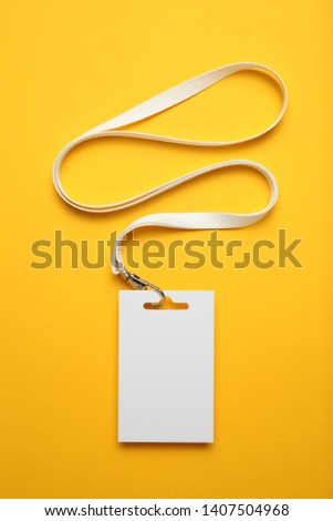 Name tag badge mockup, event identification on yellow background.  #1407504968