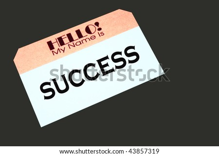 name tag with the word success printed on it