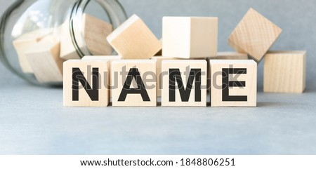 NAME word written on wood block. NAME text on wooden table for your desing, concept. ストックフォト ©