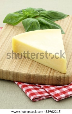 named after an area in Italy parmigiano reggiano or parmesan cheese is one of the world's most famous and delicious cheeses.   shallow d.o.f