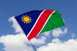 Namibia flag isolated on sky background with clipping path. close up waving flag of Namibia. flag symbols of Namibia.