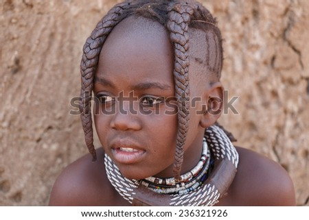 NAMIBIA, KAMANJAB, OCTOBER 10: Unidentified child Himba tribe. The Himba are indigenous peoples living in northern Namibia, in the Kunene region of South-West Africa on october 10 2014