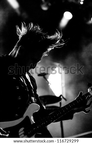 NAMPA, IDAHO - SEPTEMBER 25 : Eric Bass from Shinedown  performs for the people at the Rockstar Uproar Festival on September 25, 2012 in Nampa, Idaho.