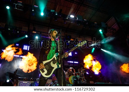 NAMPA, IDAHO - SEPTEMBER 25 : Eric Bass lit by flames while he performs at the Rockstar Uproar Festival on September 25, 2012 in Nampa, Idaho. - stock photo