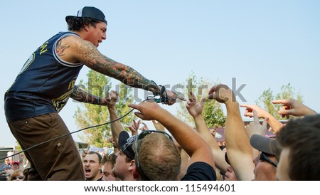 NAMPA, IDAHO - SEPTEMBER 25: Front man Sonny Sandoval from P.O.D. gets up close to the crowd at the Rockstar Uproar Festival on September 25 2012 in Nampa, Idaho