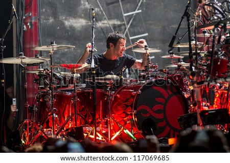 NAMPA, IDAHO - SEPTEMBER 25 : Godsmack singer Sully Erna beats the drums at the Rockstar Uproar Festival on September 25, 2012 in Nampa, Idaho.