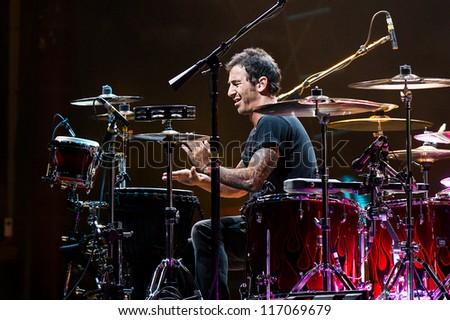NAMPA, IDAHO - SEPTEMBER 25 : Sully Erna plays drums at the Rockstar Uproar Festival on September 25, 2012 in Nampa, Idaho.