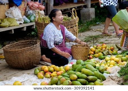 Nampan Inle Lake Myanmar 4 July 2015 Woman sells fresh vegetables and fruit on traditional asian floating market