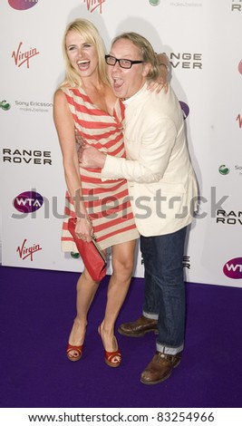 Nancy Sorrell and Vic Reeves arriving for The WTA Pre Wimbledon Party, Rooftop Gardens, Kensington London. 16/06/2011  Picture by: Simon Burchell / Featureflash