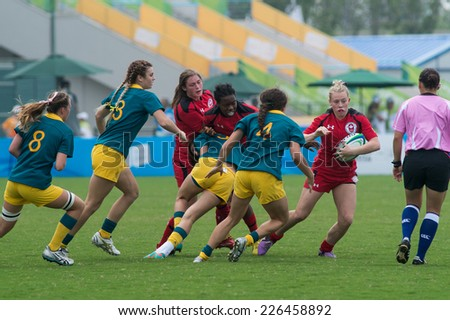 NANJING, CHINA-AUGUST 19: Australia Rugby Team (green) plays against Canada Rugby Team (red) during Day 3 match of 2014 Youth Olympic Games on August 19, 2014 in Nanjing, China. Australia wins 21-5.