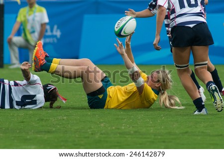 NANJING, CHINA-AUGUST 19: Australia Rugby Team (yellow) tackles USA Rugby Team (white) during semifinals match of 2014 Youth Olympic Games on August 19, 2014 in Nanjing, China. Australia wins 33-0.