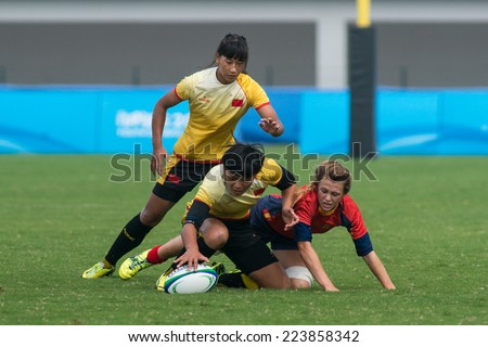 NANJING, CHINA-AUGUST 19: China Rugby Team (yellow) plays against Spain Rugby Team (red) during Day 3 match of 2014 Youth Olympic Games on August 19, 2014 in Nanjing, China. China wins 45-0.