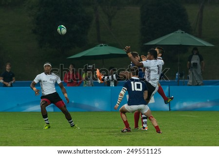 NANJING, CHINA-AUGUST 19: Fiji Rugby Team (white) plays against France Rugby Team during semifinals match of 2014 Youth Olympic Games on August 19, 2014 in Nanjing, China. France won 34-12.