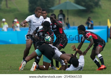 NANJING, CHINA-AUGUST 20: Fiji Rugby Team (white) plays against Kenya Rugby Team (black) during bronze medal match of 2014 Youth Olympic Games on August 20, 2014 in Nanjing, China. Fiji wins 12-0.