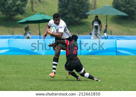 NANJING, CHINA-AUGUST 19: Fiji Rugby Team (white) plays against Kenya Rugby Team (black) during Day 3 match of 2014 Youth Olympic Games on August 19, 2014 in Nanjing, China. Kenya wins 17-12.