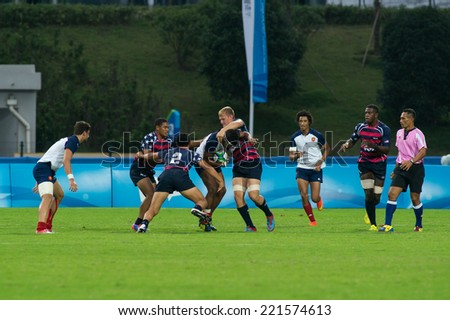 NANJING, CHINA-AUGUST 18: France Rugby Team (white) plays against USA Rugby Team (blue-red) during Day 2 match of 2014 Youth Olympic Games on August 18, 2014 in Nanjing, China.