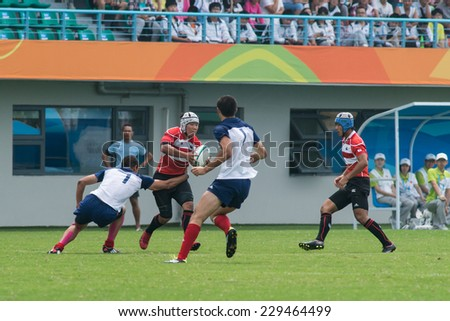 NANJING, CHINA-AUGUST 19: French Rugby Team (white) plays against Japan Rugby Team (red) on Day 3 match of 2014 Youth Olympic Games on August 19, 2014 in Nanjing, China. France wins 28-7.