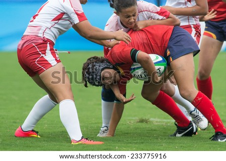 NANJING, CHINA-AUGUST 19: Spain Rugby Team (red-blue) plays against Tunisia Rugby Team (red) during Day 3 match of 2014 Youth Olympic Games on August 19, 2014 in Nanjing, China.