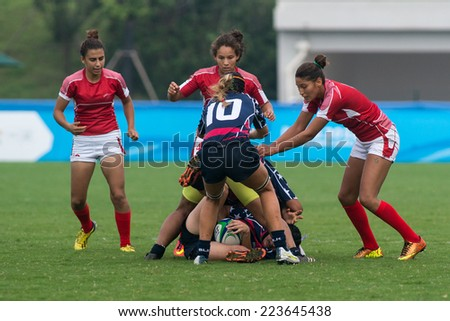 NANJING, CHINA-AUGUST 19: USA Rugby Team (blue) plays against Tunisia Rugby Team (red) during Day 3 match of 2014 Youth Olympic Games on August 19, 2014 in Nanjing, China. USA wins 26-0.