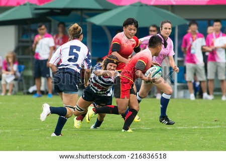 NANJING, CHINA-AUGUST 18: USA Rugby Team (white/blue) plays against China Rugby Team (red) during Day 2 match of 2014 Youth Olympic Games on August 18, 2014 in Nanjing, China.
